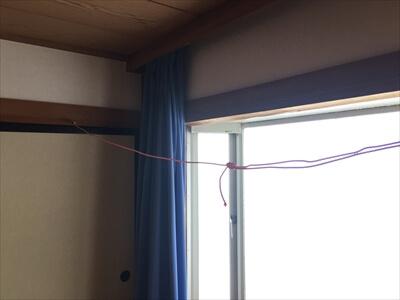 ホテルサンパティック斑尾の部屋内物干しロープ